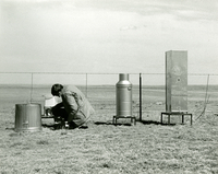 Photograph, staff working on site of National Hail Research Experiment