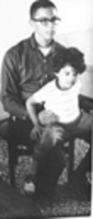 Photograph, Warren Washington in his late 20s with eldest child, Teri