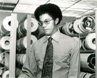 Photograph, Warren Washington in the computer room tape library