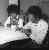 Photograph, Warren Washington with a student