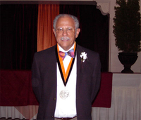 Photograph, Warren Washington with Honorary Doctorate medal from Oregon Sate University
