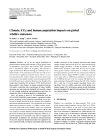 Climate, CO₂ and human population impacts on global wildfire emissions