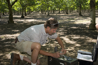 Researcher takes soil samples as part of CHATS field project (DI01680)