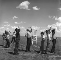 Hail researchers watch radiosonde ascend, 1976 (DI02105)