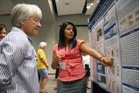 High school intern Massiel Puentes at poster session (DI02621)