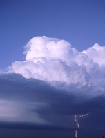 Towering cumulous clouds hover above lightning strikes (DI02712), Photograph by Greg Thompson