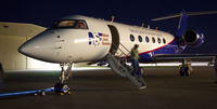 G5 Gulfsteam aircraft returns after a night of flight (DI02756), Photograph by Carlye Calvin