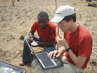 Researchers download meteorological data in Ghana (DI02465) Photo by Christine Wiedinmyer