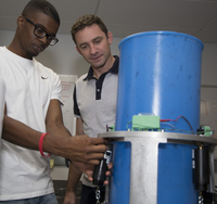 Scientist and student working on instrument