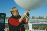 Science educator (Ned Chamberlain with instrumented balloon) (DI00670)