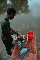 Filtering Sanga River water, Congo (DI00760), Photo by Lee Klinger