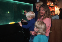 Flow Tank exhibit with a visiting family (DI00943)