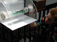Automated Dropsonde exhibit with student (DI00992)