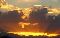 Sunset over mountains (DI02698), Photograph by Carlye Calvin